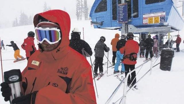 Ian Divoll helps run a lift. The sixth-largest ski resort in North America, Mt. Bachelor benefits from more than a million dollars worth of improvements in the past year.