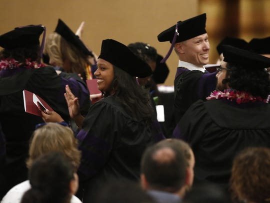Arizona Summit Law School graduates clap for their families and joke around before the commencement at the Scottsdale Resort at McCormick Ranch in Scottsdale, Arizona, on May 12, 2018.