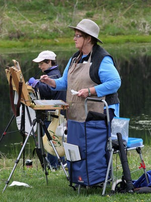 Former Marshfield resident, now of St. Germain, Ann Waisabrot paints during the Plein Air Paint-Off, Saturday, May 9, 2015, at the Hamus Nature Preserve in Marshfield. The event is part of the Creative Marshfield Weekend, which also includes the Marshfield Art Fair Sunday. In the background is Nancy Laliberte of Wausau.