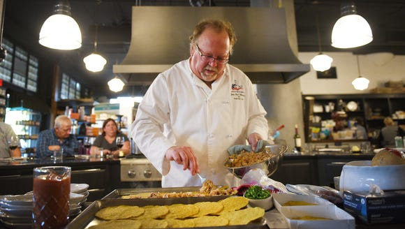 Chef John Gilbertson sprinkles shredded mojo chicken