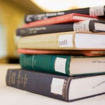 A stock image of a stack of library books.