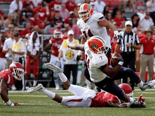 UTEP's Kavika Johnson (14) gets tripped up by an Arkansas defender during an NCAA college football game in Fayetteville, Ark., Saturday, Sept. 5, 2015. Arkansas won 48-13.
