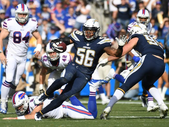 Los Angeles Chargers inside linebacker Korey Toomer (56) returns an interception past Buffalo Bills quarterback Nathan Peterman (2) for a touchdown in the first half of a NFL game at StubHub Center.