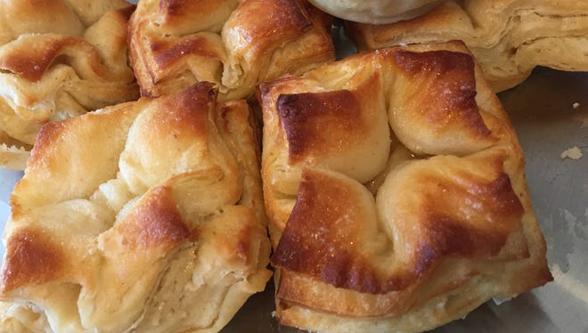 Don't miss the many buttery layers of flower-shaped buns named kouign amann, a speciality of the Bretons in France.