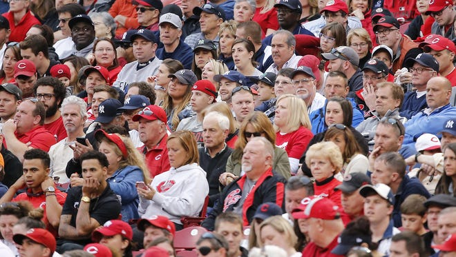 Fans here in Baseball Town have little time for cheering the Reds. Their team doesn't woo (impress) them. They just wanna sound stupid.