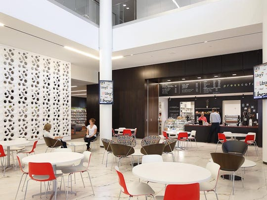 """A cafe and coffee shop is included in the new Cedar Rapids Public Library to encourage visitors to """"gather, linger and engage,"""" according to OPN Architects."""
