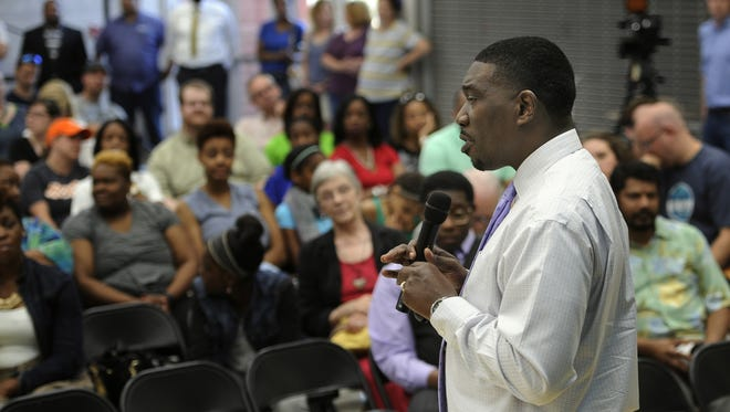 In this file photo, Metro Nashville Public Schools director Shawn Joseph conducts a community forum  at Shayne Elementary School to discuss the hiring of principals Tuesday May 31, 2016, in Nashville, Tenn. Several of Joseph's hires started off the year without Tennessee teaching licenses after moving from out of state.