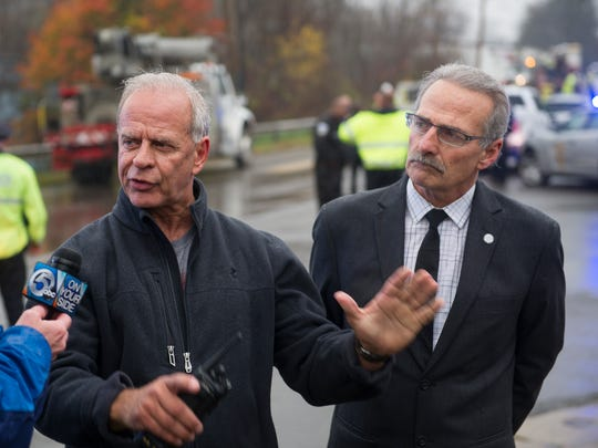 Akron police chief James Nice, left, talks to reporters as Akron Mayor Jeff Fusco watches.