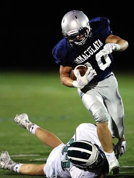 Dustin Parker ran the ball 23 times for 138 yards and three touchdowns to lead Immaculata on Friday.