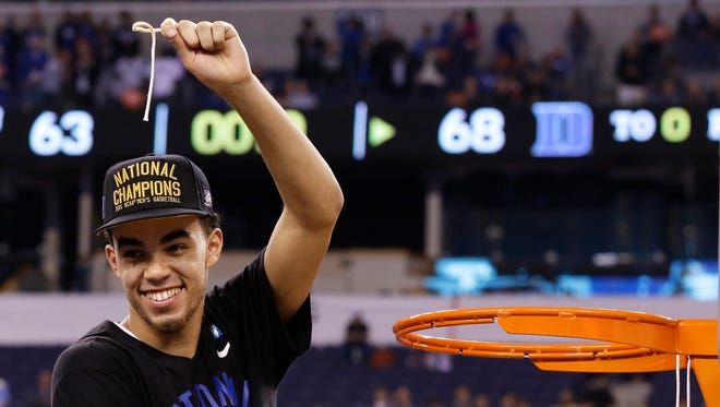 Duke's Tyus Jones cuts down the net after his team's 68-63 victory over Wisconsin in the NCAA Final Four college basketball tournament championship game Monday, April 6, 2015, in Indianapolis.