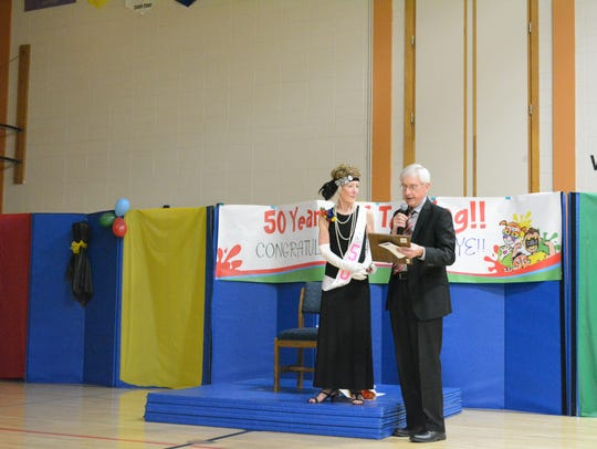 State Superintendent Tony Evers presents Stannye Meads