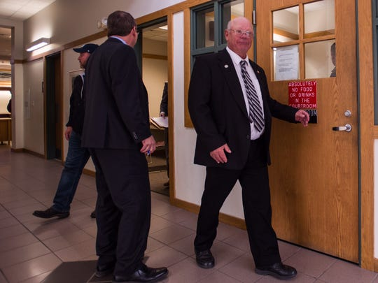 Norm McAllister enters Vermont Superior Court in St. Albans on Tuesday morning, Oct. 17, 2017, for his sentencing.  A jury found McAllsiter guilty of prohibited acts earlier this year, related to a female farm hand who McAllister arranged to have sex for money.