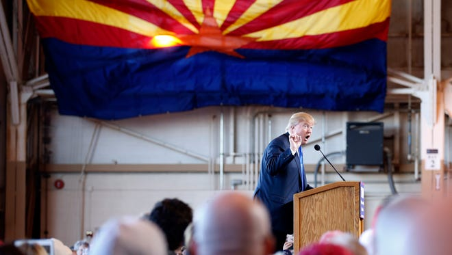 Donald Trump speaks at a campaign rally on Dec. 16, 2015, in Mesa, Ariz.