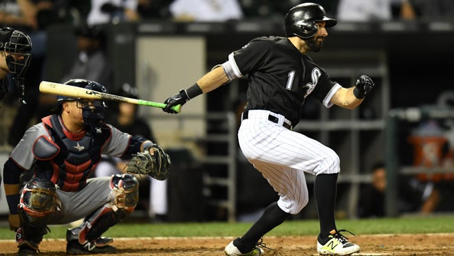 Chicago White Sox right fielder Adam Eaton (1) hits a single against the Minnesota Twins during the eighth inning at U.S. Cellular Field.