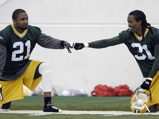 Charles Woodson, left, and Al Harris