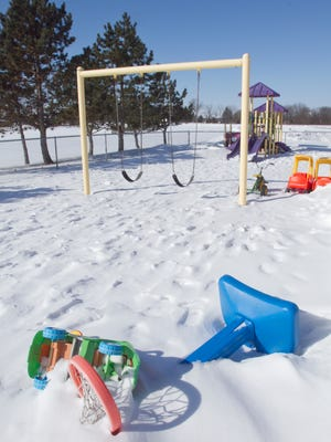 Frigid temperatures cause school closures throughout Livingston County Thursday, including Howell's Challenger Elementary where the playground lies dormant.