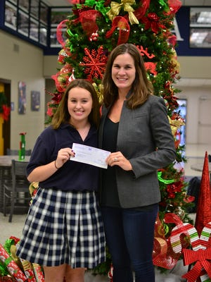 Franklin Road Academy senior Julia Scott, left, organized a race to raise funds for the Thisbe and Noah Scott Foundation.