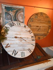 Blue Door features handmade local art, like these oversized clocks