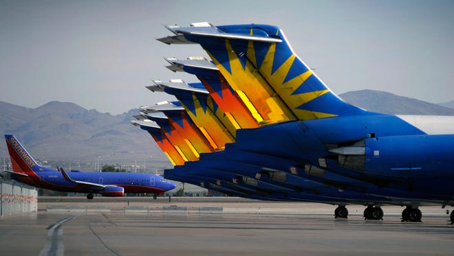 A Southwest Airlines plane taxis by parked Allegiant Air jetliners at McCarran International Airport in Las Vegas on May 9, 2013.