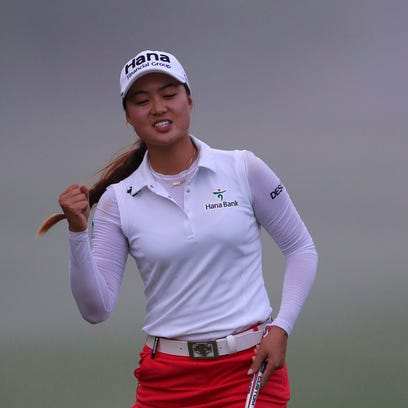 Minjee Lee of Australia reacts after making her eagle