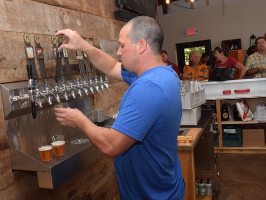 "Customers in Huckleberry Brewing Company's taproom enjoy the brewery's fundraising Ben Jammin' Fest in September. Huckleberry was named ""Best New Business"" in the Central Louisiana Chamber of Commerce's annual Business Awards."