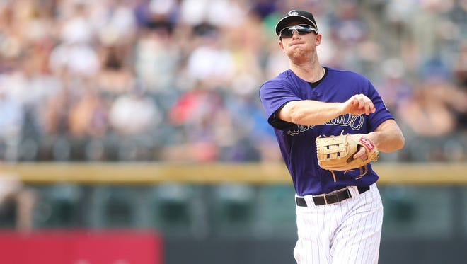 Colorado Rockies second baseman D.J. LeMahieu fields a ball against the Atlanta Braves at Coors Field.