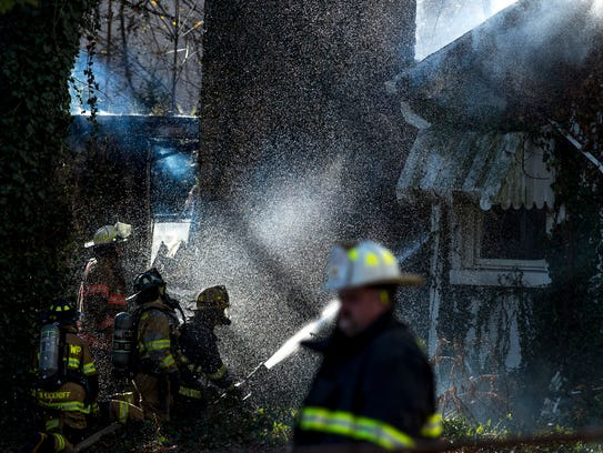 Firefighters from German and Perry townships put water