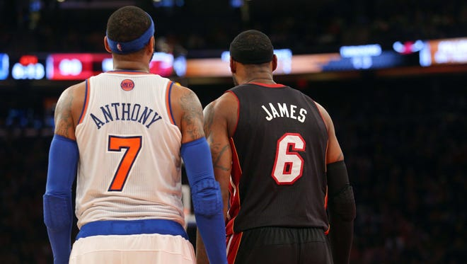 Knicks small forward Carmelo Anthony (7) and Heat small forward LeBron James (6) stand side by side during the fourth quarter of a game at Madison Square Garden on February 1, 2014.