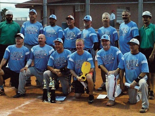 The Olympian Athletics men's slow pitch softball team recently captured the 55 AAA Division of the World Masters Championships in Las Vegas, compiling an 8-1 record, despite being seeded 34th in the 45-team field. Team members included, front row, left to right, Joe Liguori, Mike Keenan, Doug Hartzok, John Perry, Pat Daley and Mark Iorio, and back row, an unidentified umpire, Shaun Young, Keith Doleman, Randy Brookens, Roy Pittman, Carmen Loiacono, Bruce Davis, and another umpire.