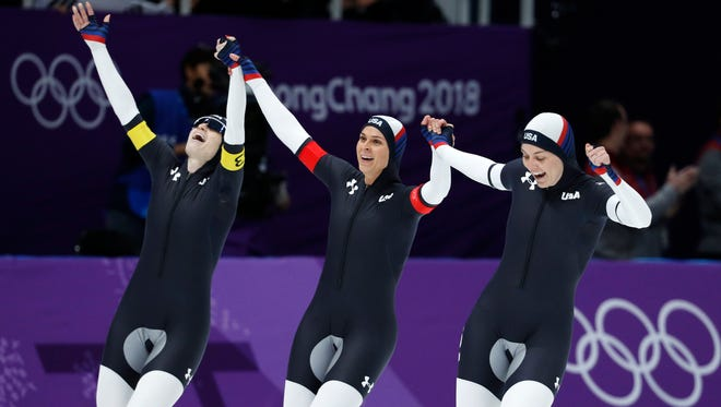 Heather Bergsma (right), Brittany Bowe (center) and Mia Manganello (left) celebrate winning a bronze medal in the women's team pursuit final speedskating race Wednesday.