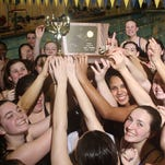 Scotch Plains-Fanwood swimmers celebrate their 100-70 victory over Princeton in the Public B girls state championship, Sunday, February 22, 2015, at TCNJ in Ewing, NJ.
