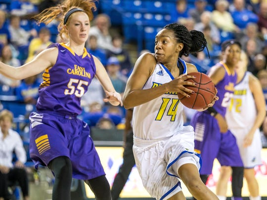 Alecia Bell drives to the basket during Sunday's game