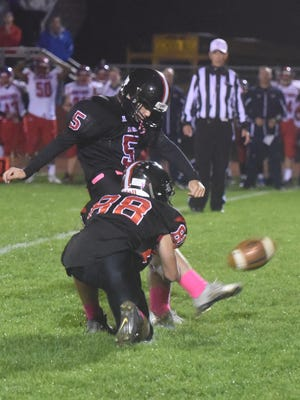 Kingsway's Sean Sandy kicks a 35-yard field goal with 30 seconds left in the second half to give the Dragons a 22-20 over Washington Township.