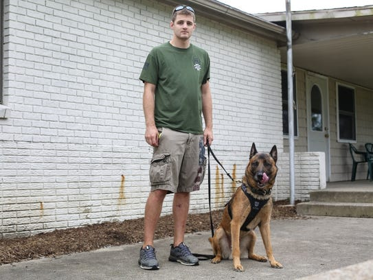Lafayette police Officer Joshua Saxton and his K-9