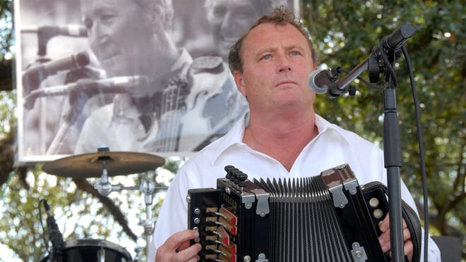 With an image of the Balfa Brothers behind him, Ray Abshire performs at the 2006 Breaux Bridge Crawfish Festival.