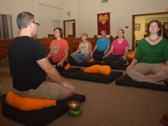 Lyndon Marcotte (front left), director for the Cenla Meditation Group, leads a meditation at First Christian Church in Pineville. The group, organized two years ago, is free and open to anyone wanting to attend and learn meditation.