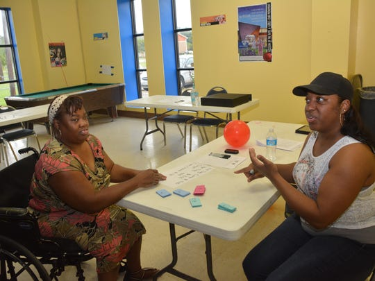 Sonya Thornton (left) and Lashanta Williams talk about the Charles Hayward Center. Macedonia Missionary Baptist Church recently took over to turn it into a youth empowerment center.