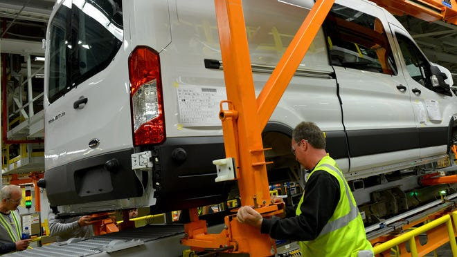Mike Shearer, a Ford Kansas CIty Assembly Plant employee, on the line building the new Transit commercial van.
