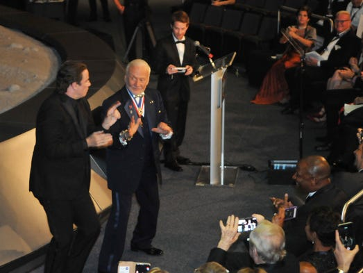 John Travolta and Buzz Aldrin dance at the gala event