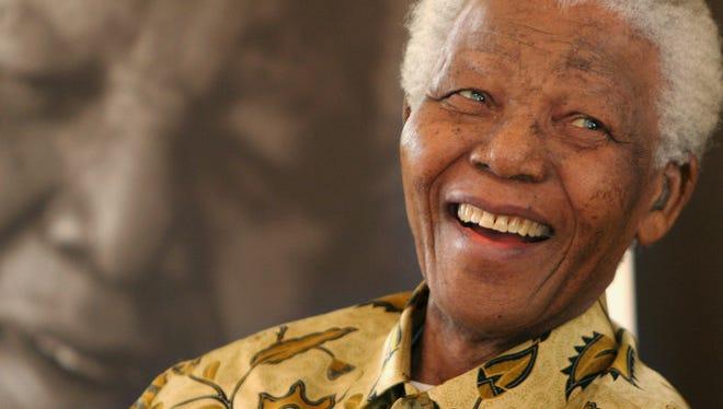 Former South African president Nelson Mandela is shown at an event at the Mandela Foundation on Dec. 7, 2005, in Johannesburg. Mandela, 95, died Dec. 5.