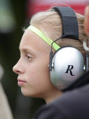 Adeline Hill, 11, of Plymouth watches from turn three Saturday at Road America.
