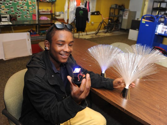 Samijai Blanks, 16, of Detroit repairs an LED light designed for an art project he is working on in the Makerspace.
