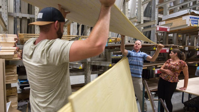 Customers purchased plywood and other hardware provisions in preparation for Hurricane Irma from Lowe's Home Improvement in Naples before Hurricane Irma struck.