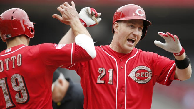 Cincinnati Reds third baseman Todd Frazier (21), right, celebrates at home plate with Cincinnati Reds first baseman Joey Votto (19) after hitting a two-run home run in the first inning.