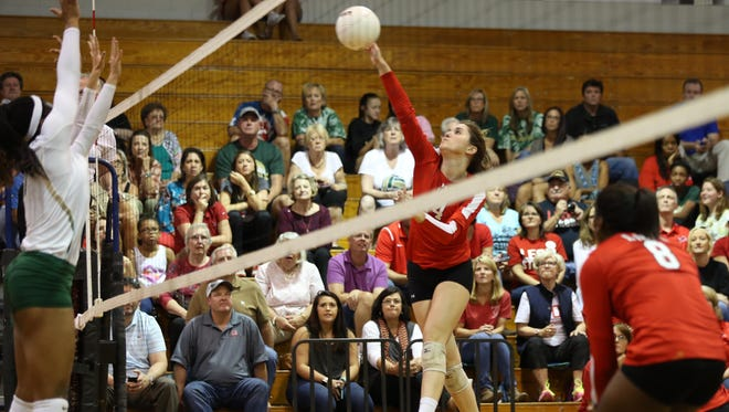 Leon's Caroline Dempsey spikes the ball against Lincoln during their District 2-8A championship game at Chiles High School on Tuesday. Leon went on to win the match 3-0.