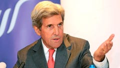 Former Secretary of State John Kerry gestures as he