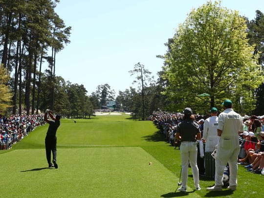 Tiger Woods tees off on the seventh hole during the