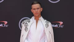 Olympic figure skater Adam Rippon arrives for the 2018