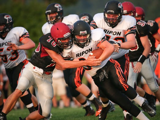 The Winneconne Wolves hosted the Ripon Tigers Friday night, August 22, 2014.