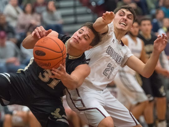 Delone Catholic's Zach Schussler (31) grabs the rebound